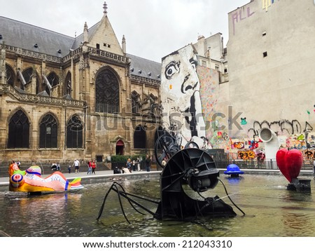 PARIS - JULY 07: View in front of Centre Georges Pompidou, the largest museum for modern art in Europe in Paris on July 07, 2014 in Paris, France - stock photo