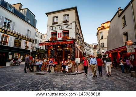 PARIS - JULY 1: View of typical paris cafe on July 1, 2013 in Paris. Montmartre area is among most popular destinations in Paris, Le Consulat is a typical cafe. - stock photo