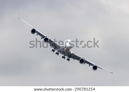 PARIS - JUN 18, 2015: Airbus A380 turning to land at Le Bourget airport . The A380 is the largest passenger airliner in the world. - stock photo