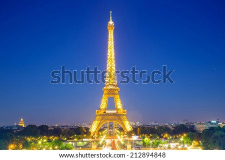 Paris - Jun 20: Eiffel Tower Light and Beam Performance Show at Dusk on Jun 20, 2014. Eiffel Tower is the highest monument in France use 20,000 light bulbs in the show.