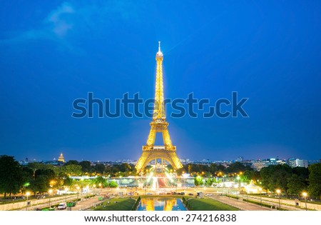 Paris - Jun 25: Eiffel Tower Light and Beam Performance Show at Dusk on Jun 25, 2014. Eiffel Tower is the highest monument in France use 20,000 light bulbs in the show. - stock photo