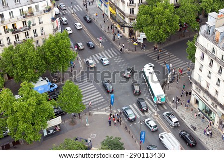 PARIS - JUN 19, 2015: View on the Rue de Rivoli crossing the Boulevard de S�©bastopol. The street is one of the most famous shopping streets of Paris. - stock photo