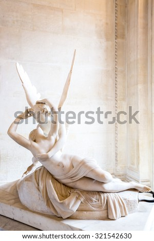 Paris - June 23: Cupid statue on June 23, 2014 in Paris. Antonio Canova's statue Psyche Revived by Cupid's Kiss, first commissioned in 1787, exemplifies the Neoclassical devotion to love and emotion. - stock photo
