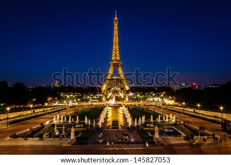 PARIS - JUNE 29: Eiffel Tower light show at dawn on June 29, 2013 in Paris, France. Eiffel Tower is the highest and most visited monument in France and use 20,000 light bulbs in the night show.