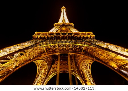 PARIS - JUNE 29: Eiffel Tower light show on June 29, 2013 in Paris, France. Eiffel Tower is the highest and most visited monument in France and use 20,000 light bulbs in the night show.