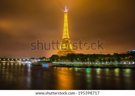 PARIS - JUNE 15: Eiffel Tower on June 22, 2012 in Paris. Eiffel tower is one the most popular attractions in Paris