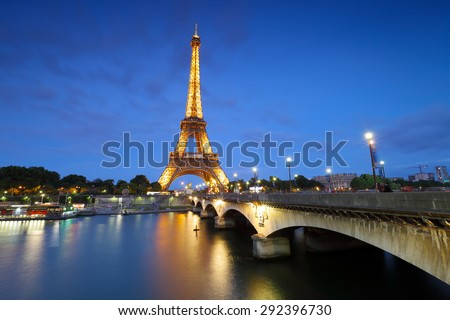 PARIS - JUNE 19, 2015: Eiffel Tower on June 19, 2015 in Paris. Eiffel tower is one the most popular attractions in Paris