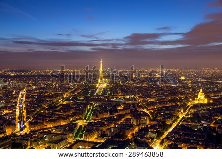 PARIS - JUNE 17, 2015: Evening view on Paris and the Eiffel Tower. The Eiffel tower was erected in 1889 and has become both a global cultural icon of France and the world. - stock photo