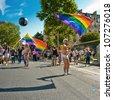 PARIS - JUNE 30: Gays wave LGBT's flags at the Gay Pride on June 30, 2012 in Paris. - stock photo
