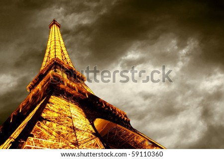 PARIS - JUNE 22 : Illuminated Eiffel tower at night sky June 22, 2010 in Paris. The Eiffel tower is one of the most recognizable landmarks in the world. - stock photo