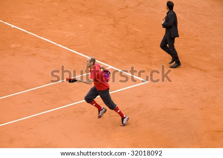 PARIS - JUNE 7: Infringer ran in on court with flag at French Open, Roland Garros on June 7, 2009 in Paris, France.