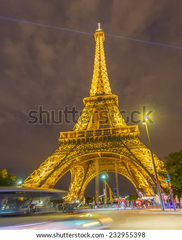 PARIS - JUNE 12, 2014: Lights of Eiffel Tower after sunset. La Tour Eiffel is the most visited landmark in France.
