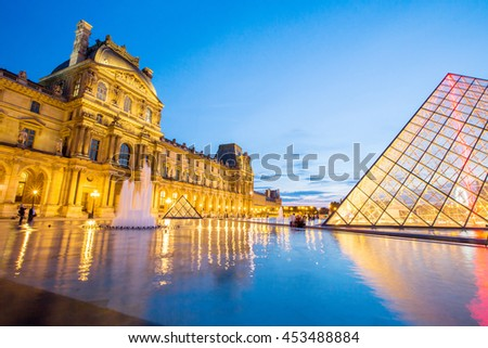 Paris - June 3: Louvre museum at dusk on June 3, 2015 in Paris. This is one of the most popular tourist destinations in France displayed over 60,000 square meters of exhibition space..