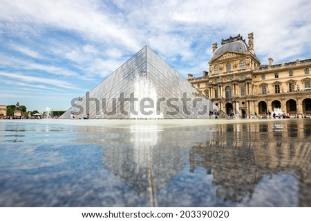 Paris - June 23: Louvre museum on June 23, 2014 in Paris. This is one of the most popular tourist destinations in France displayed over 60,000 square meters of exhibition space..  - stock photo