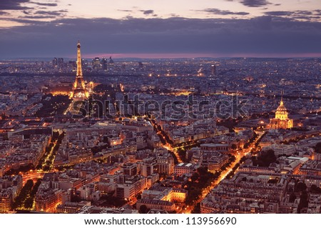 PARIS - JUNE 22 : Night view of Paris with Eiffel Tower and St. Pierre de Montmartre on June 22 2012 in Paris - France.