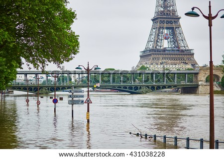 PARIS - JUNE 3: Paris flood with extremely high water on June 3, 2016 in Paris, France. Drowned road signs on the Seine - stock photo