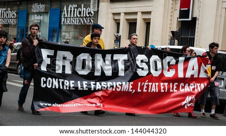 PARIS - JUNE 23:  People march in the streets of Paris in anti fascist protest following death of leftist activist Clement Mericas after attack by skinheads as seen on June 23, 2013 in Paris, France.