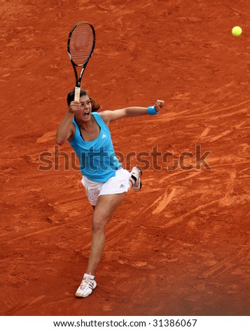 PARIS - JUNE 1: Sorana Cirstea of Romania in action at French Open, Roland Garros on June 1, 2009 in Paris, France. - stock photo