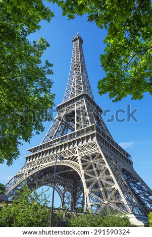 PARIS - JUNE 23: The Eiffel Tower with blue sky on June 23, 2015 in Paris. The Eiffel tower is the most visited monument of France with about 6 million visitors every year.  - stock photo