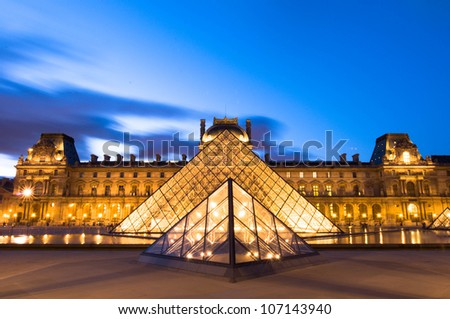 PARIS- JUNE 30: The Louvre Art Museum on june 30, 2012 in Paris. The history of this most famous museum goes back 800 years of continuous transformations from fortress to palace and today museum. - stock photo