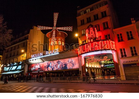 PARIS - June 25: The Moulin Rouge at night, on June 25, 2013 in Paris, France. Moulin Rouge is a famous cabaret built in 1889,  locating in the Paris red-light district of Pigalle.