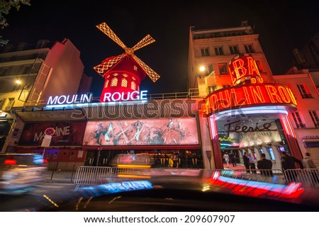 PARIS - JUNE 22, 2014: The Moulin Rouge night lights in Paris, France. Moulin Rouge is a famous cabaret built in 1889, locating in the Paris red-light district of Pigalle.