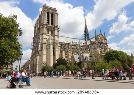 PARIS - JUNE 19, 2015: The Notre Dame Cathedral is located in the heart of Paris, and is one of its most popular attractions of the city. - stock photo