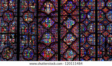 PARIS - JUNE 05: The Sainte-Chapelle one of the most visited landmark in Paris, June 05, 2012. This 1246 inspired monument features 15 wonderful stain-glass windows in Paris. - stock photo