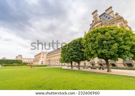 PARIS - JUNE 15, 2014: Tourists in Tuileries Gardens on a summer day. Paris is visited by more than 30 million people every year.