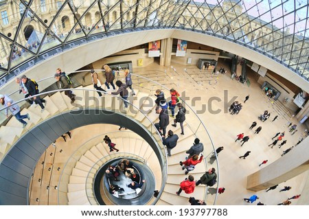 PARIS - MAR 1: Interior view of the Louvre Museum (Musee du Louvre), housed in the Louvre Palace (originally built as a fortress) on March 1, 2014 in Paris, France. - stock photo
