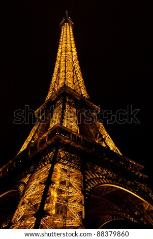 PARIS - MARCH 12: Eiffel Tower at night on March 12, 2011 in Paris, France. The Eiffel tower is the most visited monument of France with about 6 million visitors every year. - stock photo