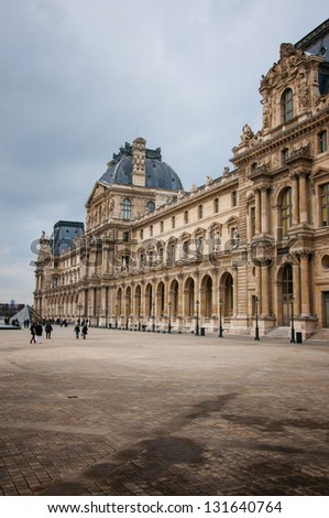 PARIS - MARCH 07: Famous  Louvre Museum March 07, 2013 in Paris France. The Louvre Museum is the most visited museum in France. - stock photo