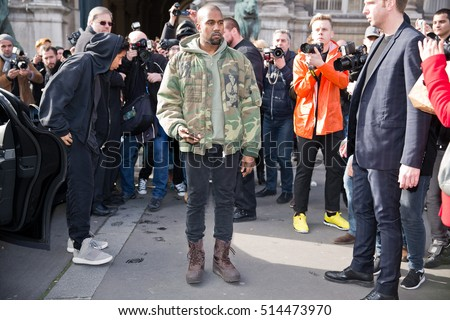 PARIS-MARCH 4, 2015. Kanye West posing for photographers in front of the Dries van noten fashion show. Ready to wear 2015/2016. Paris Hotel de ville.