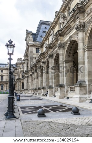 PARIS - MARCH 18: Louvre building on March 18, 2012 in Louvre Museum, Paris, France. With 8.8 million annual visitors, Louvre is consistently the most visited museum worldwide. - stock photo