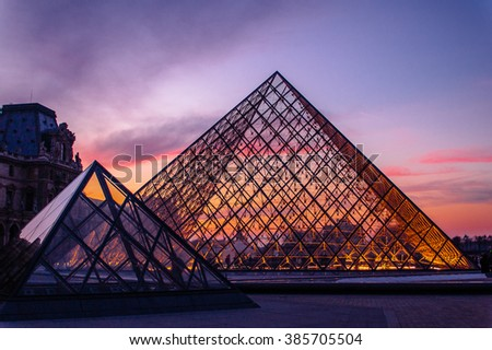 PARIS - March 27, 2006: The Musee du Louvre and it's glass pyramid designed by I.M Pei, is one of the world's largest museums, the most visited art museum in the world and a historic monument.