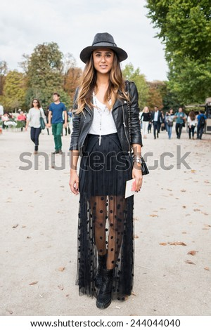 PARIS - MARS 5, 2013: Stylish European woman with black leather jacket in the Tuileries Garden. Paris Fashion Week: Ready to Wear 2013/2014 is held from February 26 to March 6, 2013. - stock photo