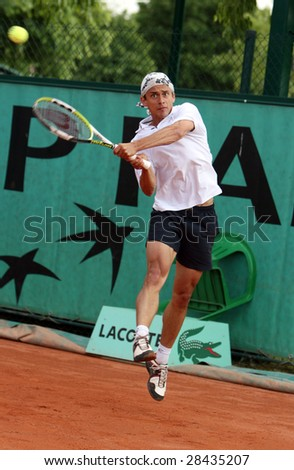 PARIS - MAY 20: Austria's professional tennis player Rainer Eitzinger during the match at French Open, Roland Garros, May 20, 2008 in Paris, France. - stock photo