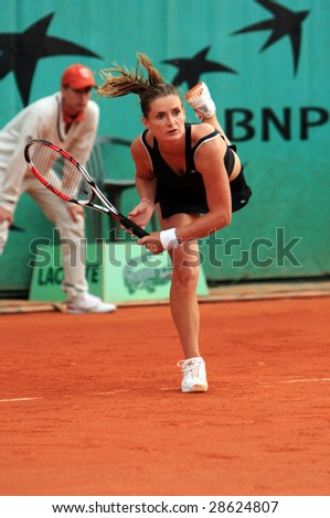 PARIS - MAY 21: Czech professional tennis player IVETA BENESOVA serves during her match at French Open, Roland Garros on May 21, 2008 in Paris, France. - stock photo