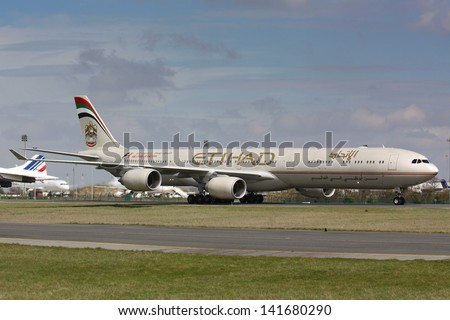 PARIS - MAY 29: Etihad Airbus A340-500 taxis to take off on May 29, 2010 in Paris, France. Etihad is one of the most expensive and rated top 5 best airlines in the world - stock photo