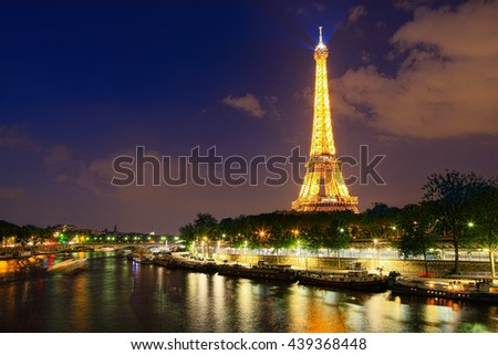 PARIS - MAY 27, 2016: Famous  Eiffel tower and Seine river at night  - stock photo