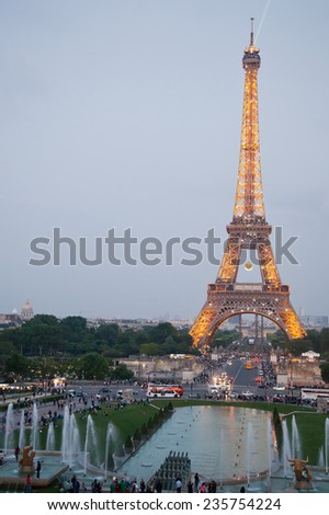 PARIS-MAY 30: Illuminated Eiffel Tower on May 30, 2014. As a top business and cultural center, Paris is one of the most visited cities in the world. - stock photo