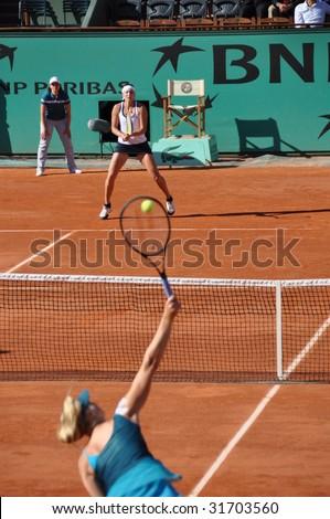 PARIS - MAY 29: Maria Sharapova of Russia versus Yaroslava Shvedova at French Open, Roland Garros on may 29, 2009 in Paris, France. - stock photo