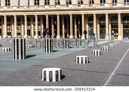 PARIS - MAY 13, 2014: Palais-Royal (1639), originally called Palais-Cardinal, it was personal residence of Cardinal Richelieu in Paris. Columns Buren (1985). - stock photo