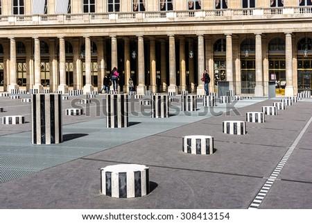 PARIS - MAY 13, 2014: Palais-Royal (1639), originally called Palais-Cardinal, it was personal residence of Cardinal Richelieu in Paris. Columns Buren (1985). - stock photo