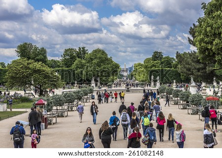 PARIS - MAY 14, 2014: Parisians and tourists in famous Tuileries garden. Tuileries Garden (Jardin des Tuileries) is a public garden located between the Louvre Museum and Place de la Concorde. France.