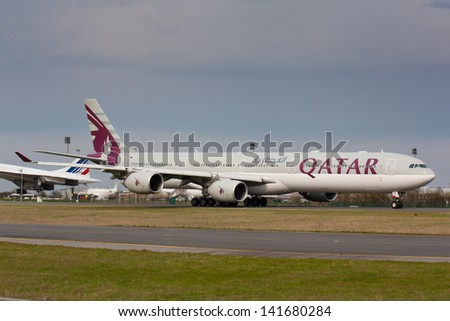 PARIS - MAY 29: Qatar Airways Airbus A340-500 taxis to take off on May 29, 2010 in Paris, France. Qatar Airways is rated 3rd best airlines in the world Qatar airline is flag carrier airline of Qatar - stock photo