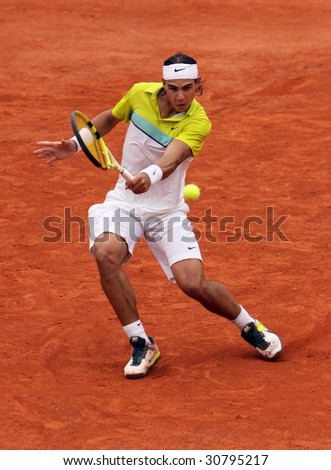 PARIS - MAY 23: Rafael Nadal of Spain during the match at French Open, Roland Garros on May 23, 2009 in Paris, France. - stock photo