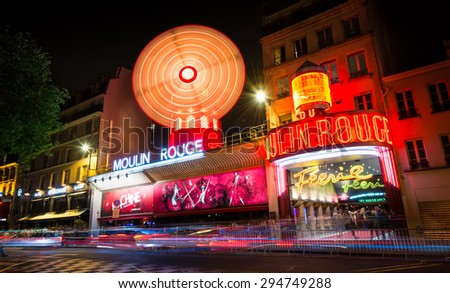 PARIS - May 10th 2015: The Moulin Rouge, a favorite destination for tourists, locals, and celebrity performances since its opening in 1889. Paris, France, May 10th, 2015.