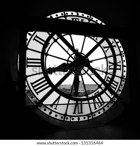PARIS - MAY 08: The Orsay Museum (Musee d'Orsay) clock, on May 08, 2012 in Paris, France. The Orsay Museum is the largest in the world collection of impressionist and post-impressionist masterpieces. - stock photo