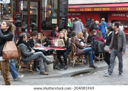 PARIS - MAY 1: Typical Montmartre Paris cafe on 2013. Montmartre area is among most popular destinations in Paris, many artists worked around the Montmartre such as Pablo Picasso or Vincent van Gogh